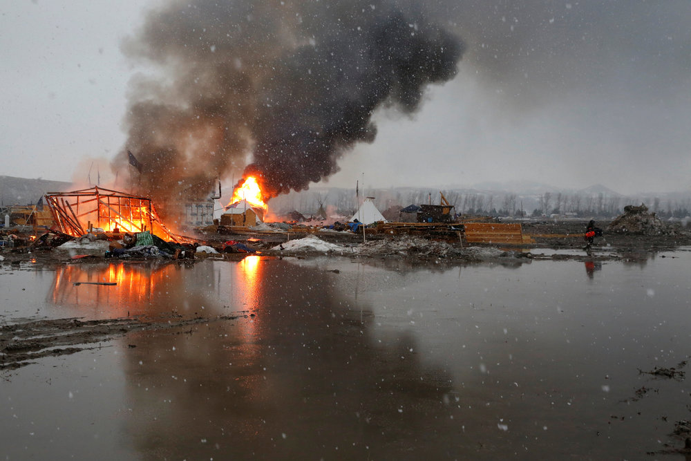 Standing Rock ceremonially burns camp as they face final eviction February 22, 2017. REUTERS/Terray Sylvester
