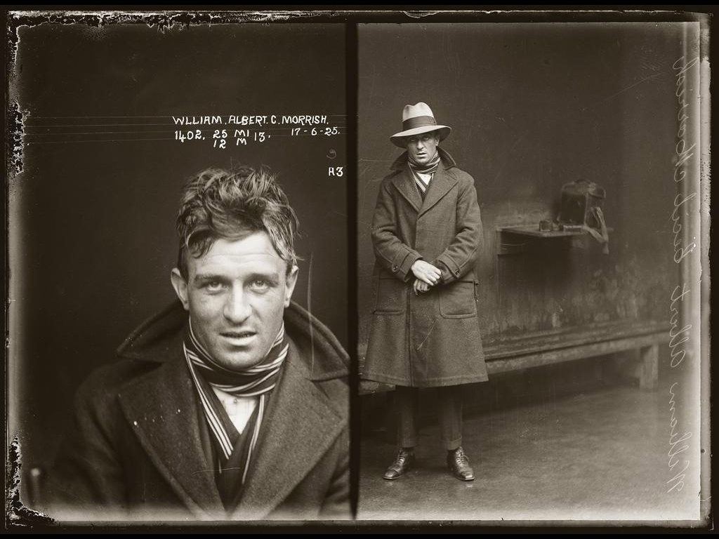 well dressed 1920's gangster in jail