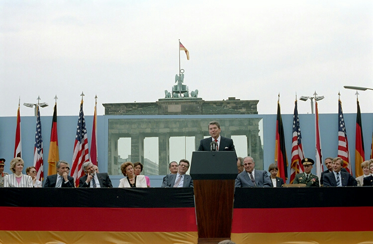 "Reagan speaking at the Brandenburg Gate, 1987. Rather than asking that the wall be ""extended"" or ""reinforced,"" he asked that it be torn ""down."""