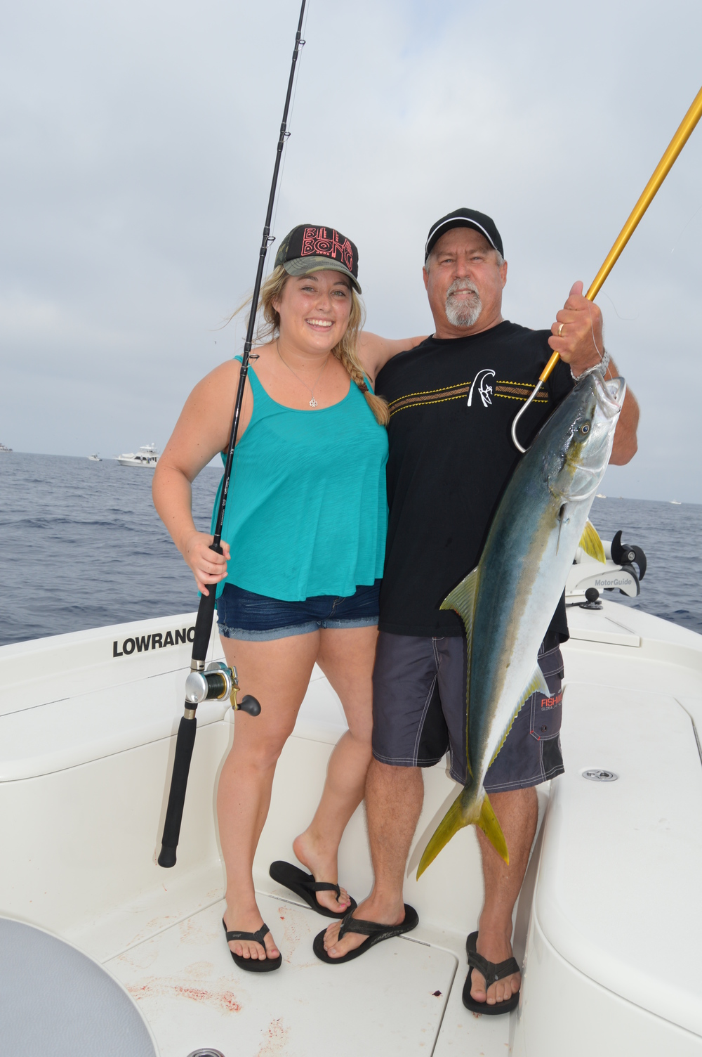 Proud dad Mike sinking the gaff in Caitlin's first Yellowtail!