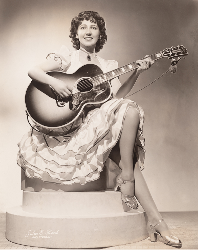 Peggy Eames with her 1938 Gibson Super Jumbo custom acoustic guitar.