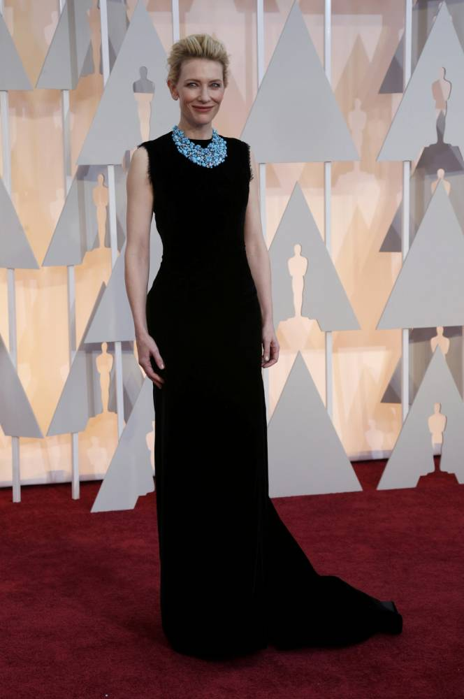 This year's red carpet was definitely the most low-key. If anything proved that, it was Cate's black Maison Margiela lace dress. But, what elevated it other than the fact Cate was wearing it, was the stunning turquoise statement necklace and the cut-out back. It was effortless elegance.