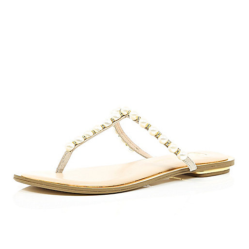 LIGHT PINK PEARL STRAP SANDALS   £28.00      Treat your summer wardrobe to a pretty update with the help of these light pink sandals. Their simple strap design is embellished with lustrous pearls and gemstones. Click photo to shop.