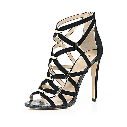 BLACK SUEDE CAGED GOLD TRIM SANDALS   £65.00 Shop click the following link   River Island        There's nothing more sexy than a pair of glamorous caged black heels. Whether it's cocktail hour, or a special occasion, these metallic trim heels have got you covered, and feature a zip back fastening for ease of wear. Heel height 11cm.     Product no: 666481