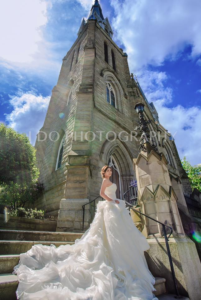 Bride on the steps of the Holy Rosary Church