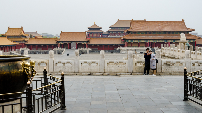 Young couple taking a selfie inside the Forbidden City in Beijing. © jwamsterdam.com