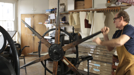 Printing on a nineteenth-century star-wheel copper plate rolling press.
