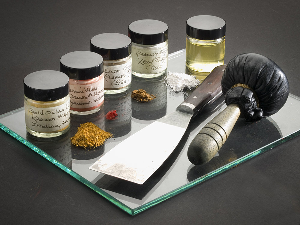 Historic pigments used to mix golden yellow ochre ink, shown with palette knife and leather ink dauber