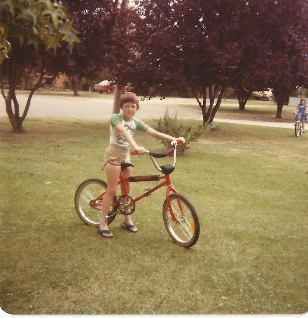 A red bike, thongs, Stubbie shorts and a bad haircut......Lets Ride!!!