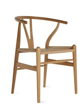 Wishbone Chair . Designed by Hans J. Wegner for Carl Hansen & Son  now at  Design Within Reach . Knock offs are available for less at  Overstock  for $163.99