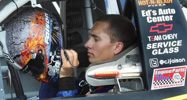 CJ Faison getting strapped in his NASCAR Camping World Truck at Dover