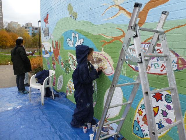 children getting involved in the artwork