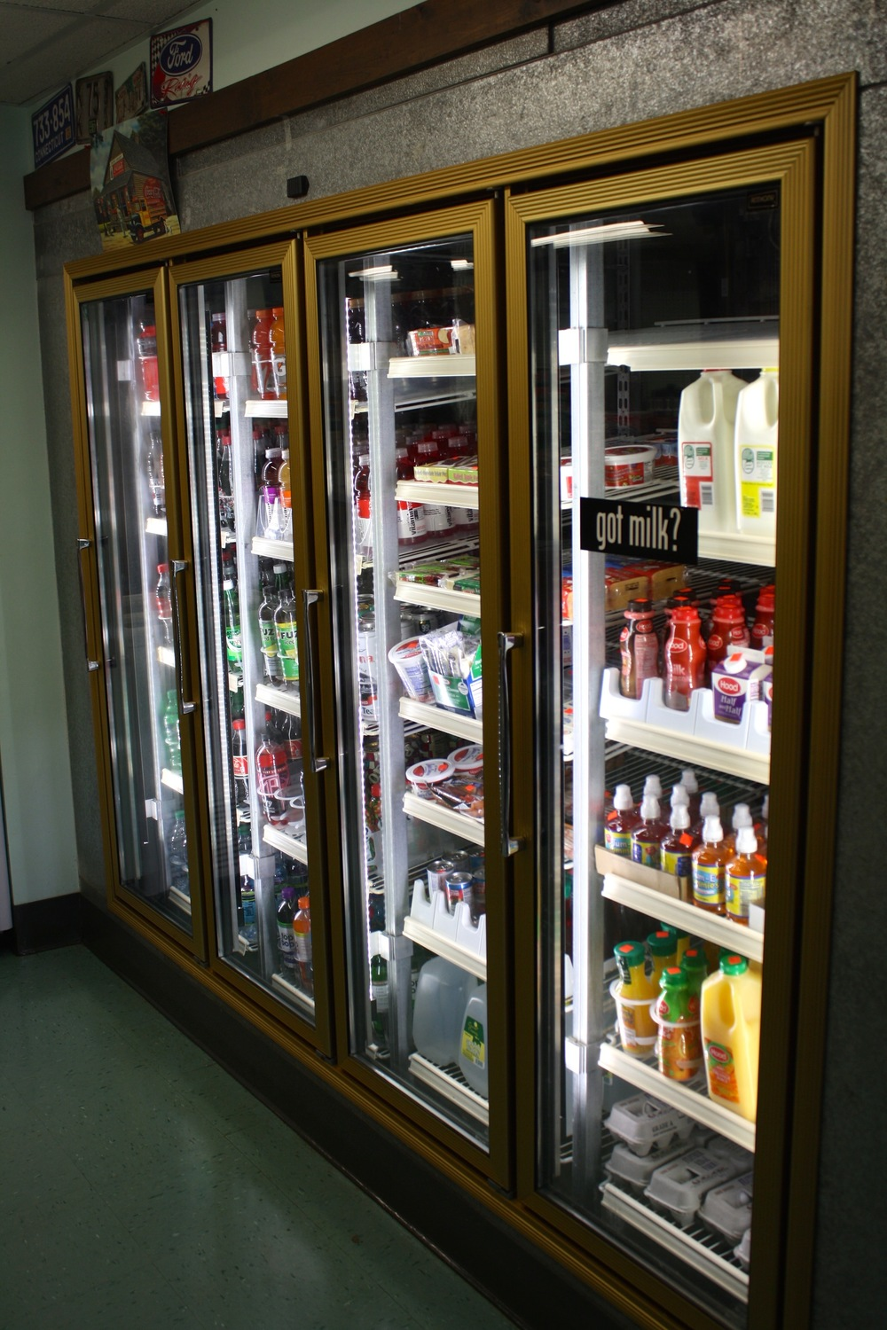 soda, water, milk, and snacks in the cooler