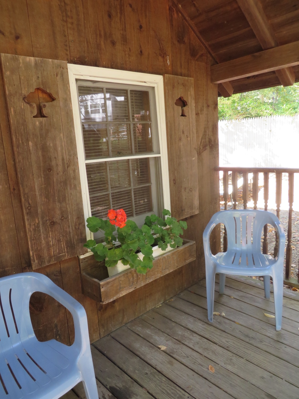 front porch with chairs at the cabin