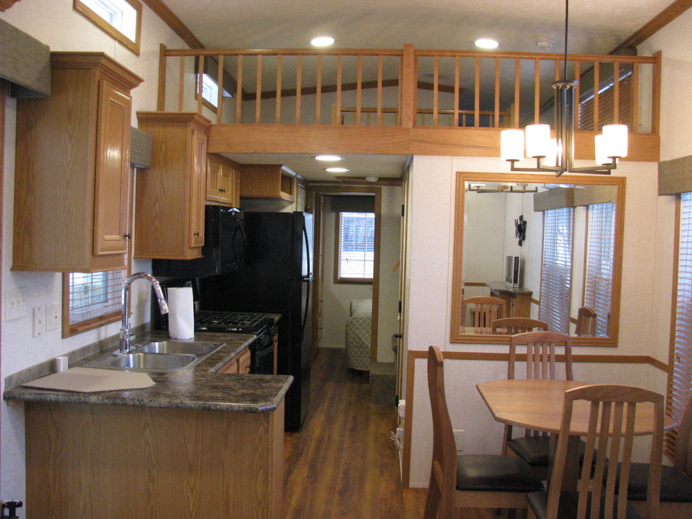 kitchenette, dining room, and loft of skyline trailer