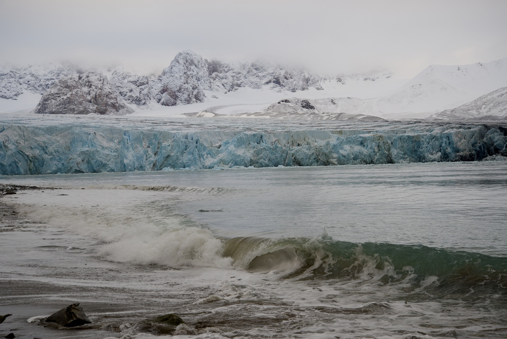 "After a calving glacier comes a ""tsunami""--a wave that is the result of the giant ripples made by mammoth chunks of ice toppling into the sea."