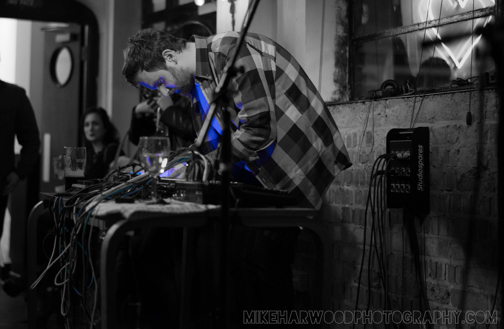 A friend playing his synthesiser at a gig