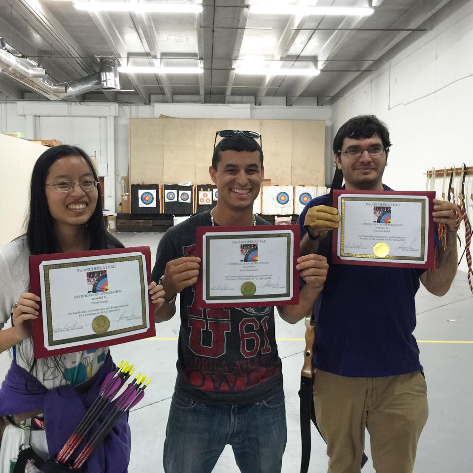 VP Vivian, Member Javier, and Member Donovan with Certificates of Appreciation for Outstanding Participation