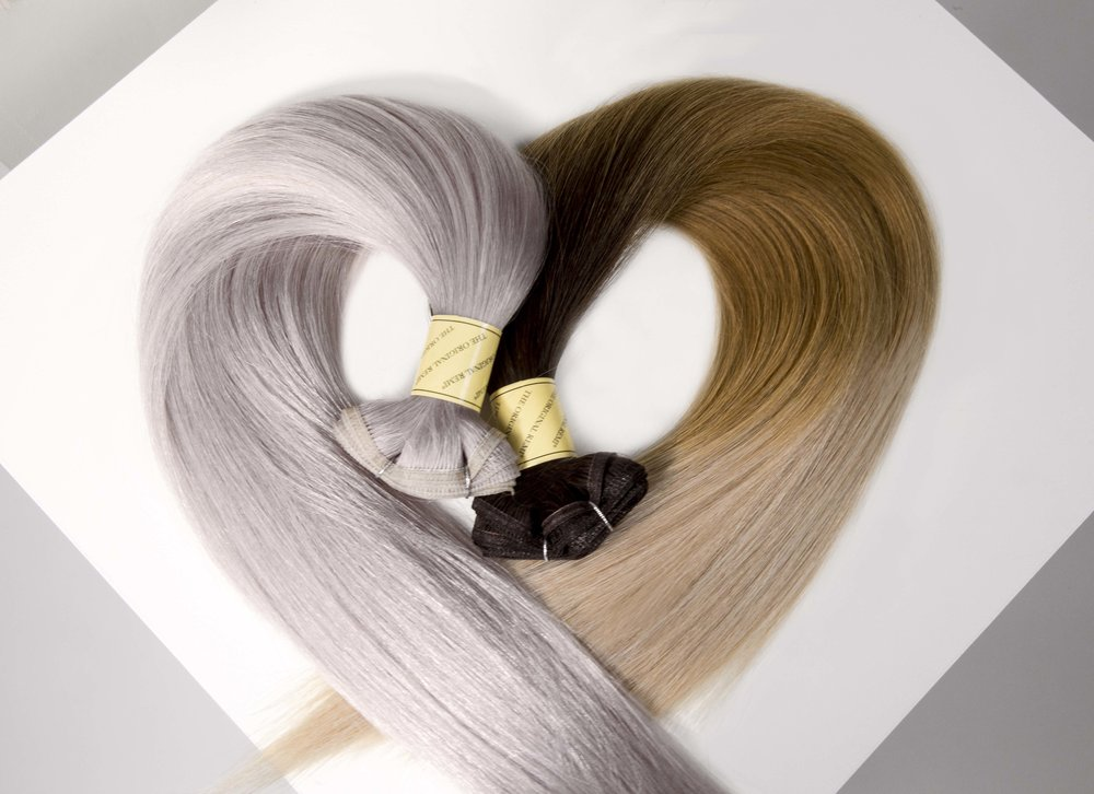 Color Blends - Our color blends range from specialty ombré affects to iconic, classic favorites to modern-day pops-of-color.Designed to blend seamlessly, there's a shade for everyone from the demure to the dramatic. Understated in a variety of specialty blends and colors, each Seamless Weft™ can also be custom colored to fit your dream hair goals.