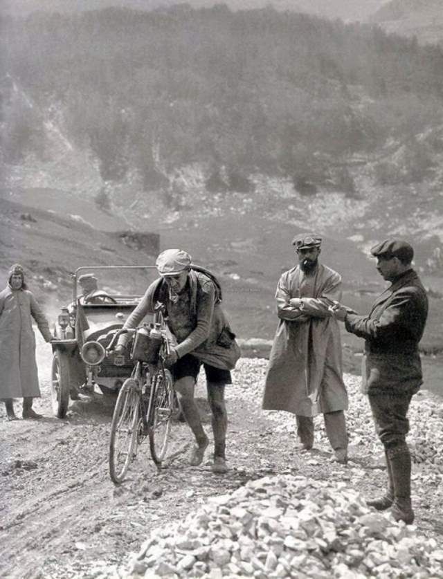 "Octave Lapize on his way up the Col du Tourmalet! ""Caution: Road Works""."