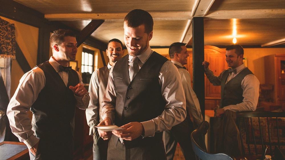 21-groom-recieving-gift-from-bride.jpg