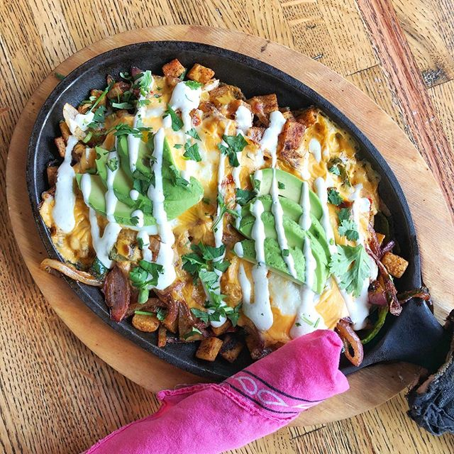 Brunch special!  Skillet with potatoes, peppers and onions, cheese, queso, 2 eggs, avocado, charred chile salsa and garlic crema.  Plus $2 mimosas and $3 bloodys... Can I get an amen?!