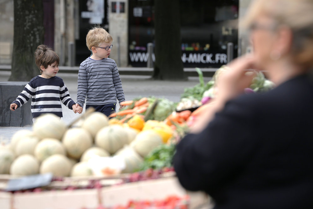 Bordeaux, 2015. Two boys explore the delights of their local market whilst safely hand-in-hand.