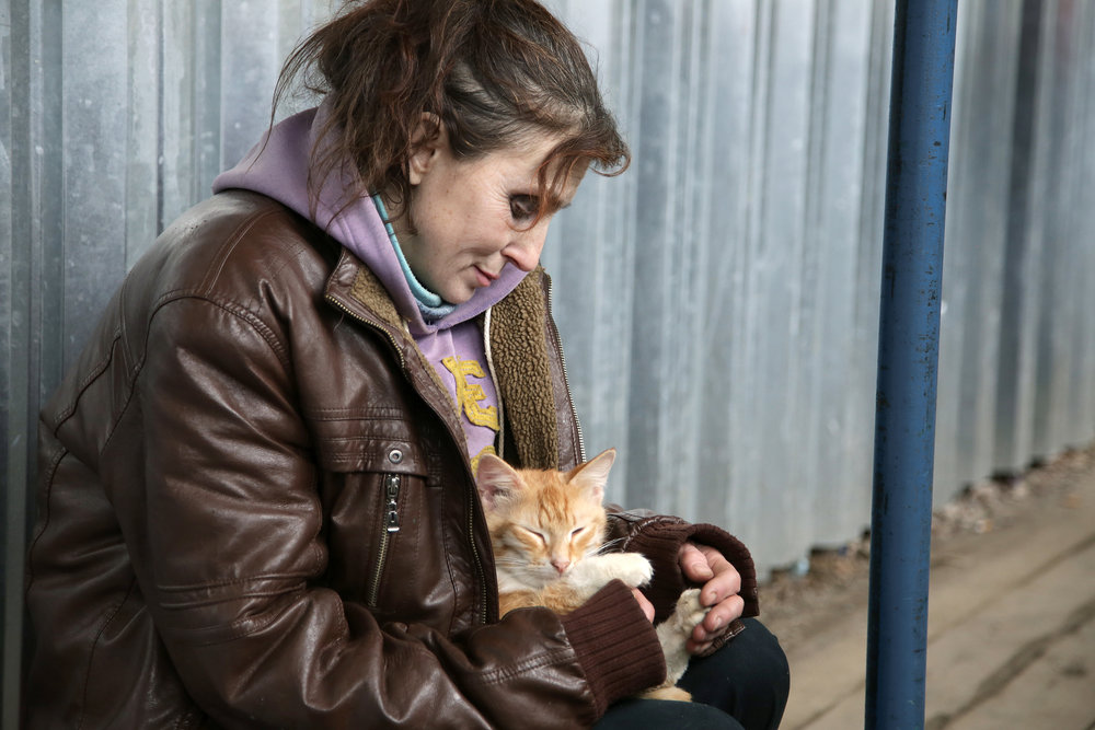 Moscow, 2015. Seemingly rejected from society, a homeless lady regains a sense of purpose by caring for an abandoned cat.