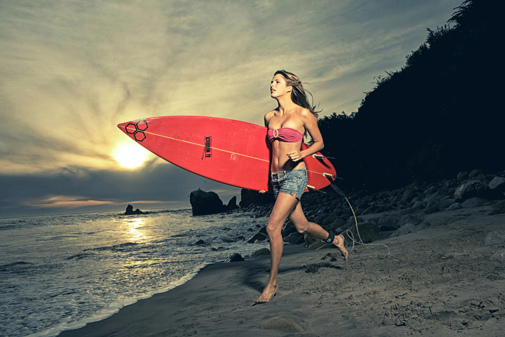 Surfing girl, by Heidi Laughton