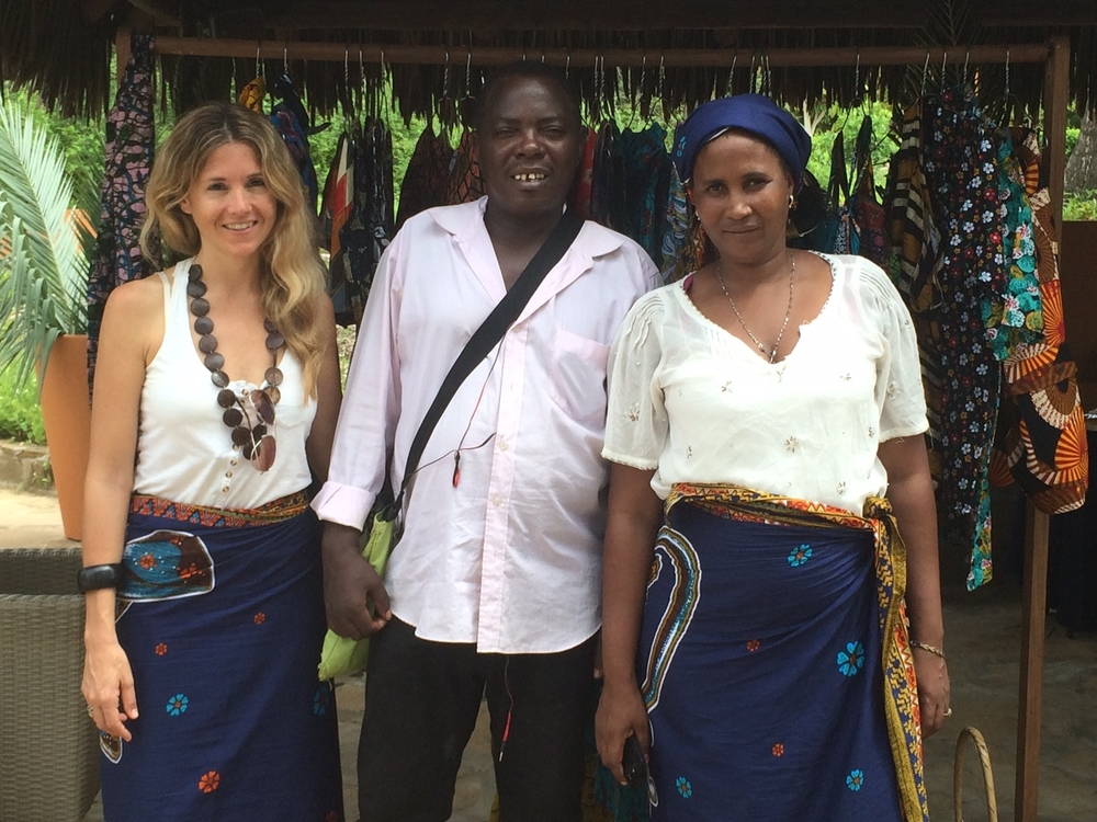 Founder Sarah Bove, Head Tailor Ntasha, and Isabelle at a fair in Pemba for Mozambique's National Women's Day.