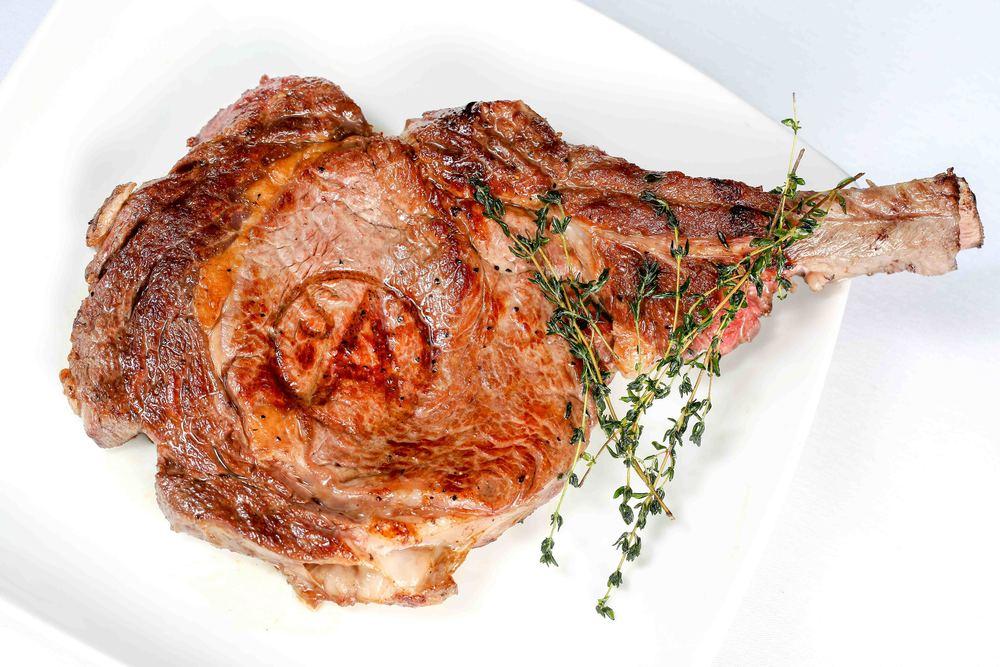 Cowboy Bone-In Ribeye Signature Steak