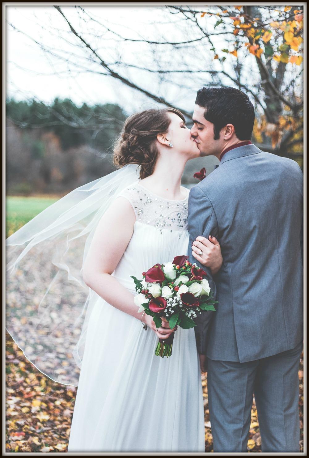 Newlywed Kiss during Autumn Wedding