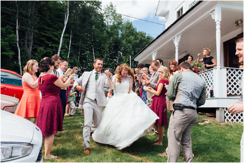 Bride and groom make wedding reception exit with bubbles and silly string