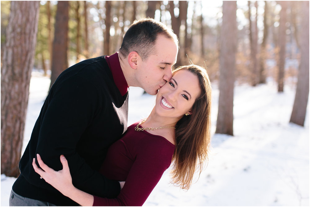 Classy winter kiss engagement at Rollins Park in Concord, New Hampshire