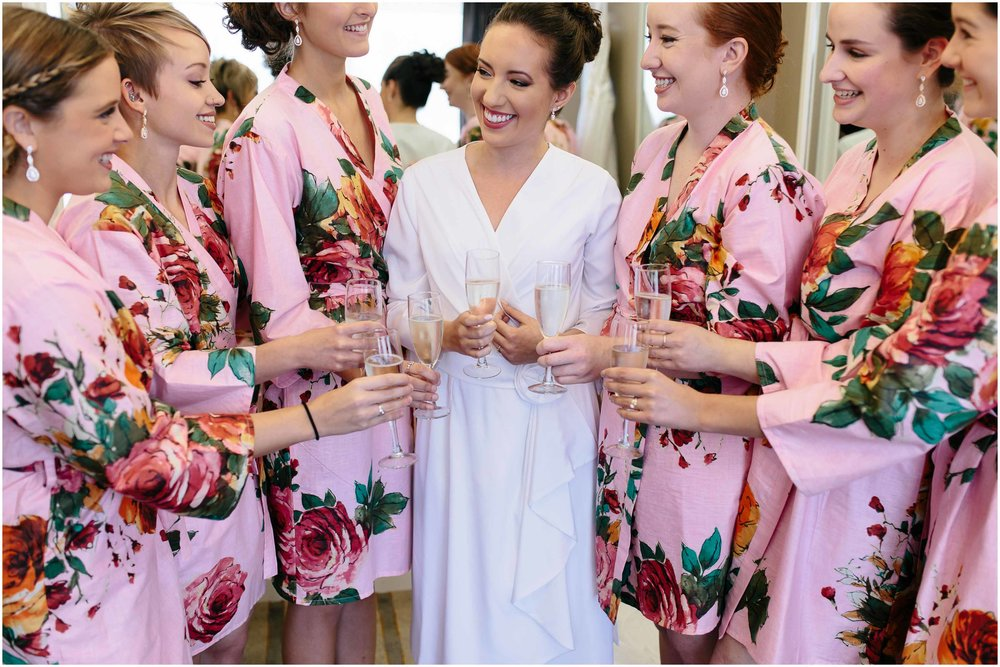 Chic New Hampshire Wedding at Manchester Country Club Bedford - bride and bridesmaids floral robes