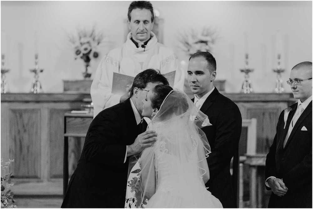 Chic New Hampshire Wedding at Manchester Country Club Bedford - bride kissing father