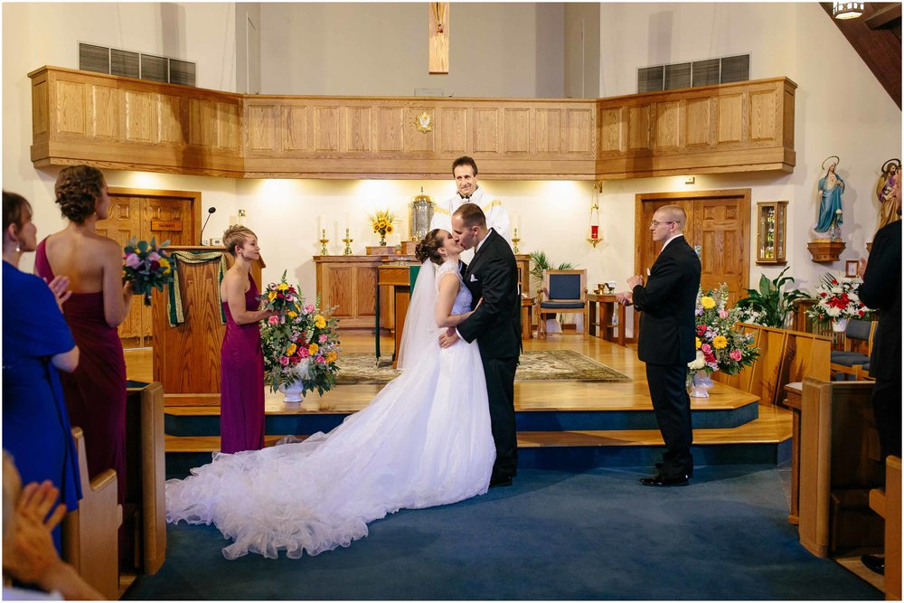 Chic New Hampshire Wedding at Manchester Country Club Bedford - Immaculate Heart of Mary Church bride and groom kiss