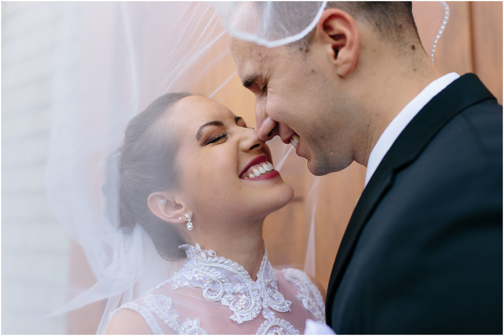 Chic New Hampshire Wedding at Manchester Country Club Bedford - bride and groom eskimo kisses