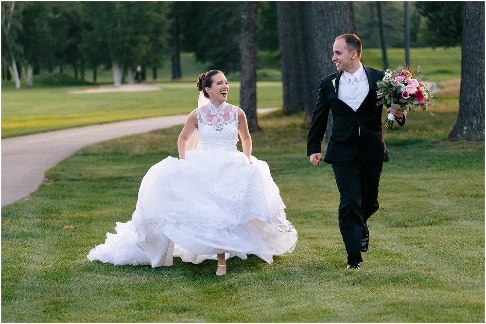 Chic New Hampshire Wedding at Manchester Country Club Bedford - adventurous bride and groom running