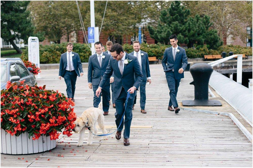 Nautical Massachusetts Jewish Wedding in the Boston Navy Yard groom and groomsmen and dog