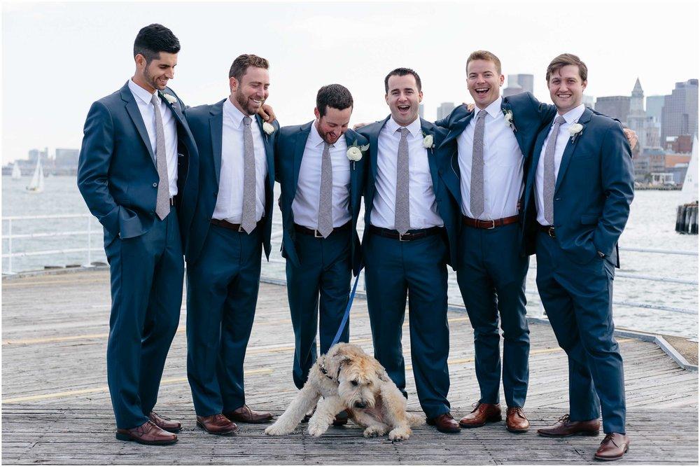 Nautical Massachusetts Jewish Wedding in the Boston Navy Yard laughing groom and groomsmen and dog