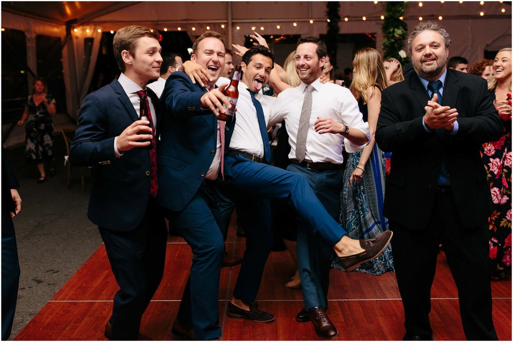 Nautical Massachusetts Jewish Wedding in the Boston Navy Yard reception groom partying