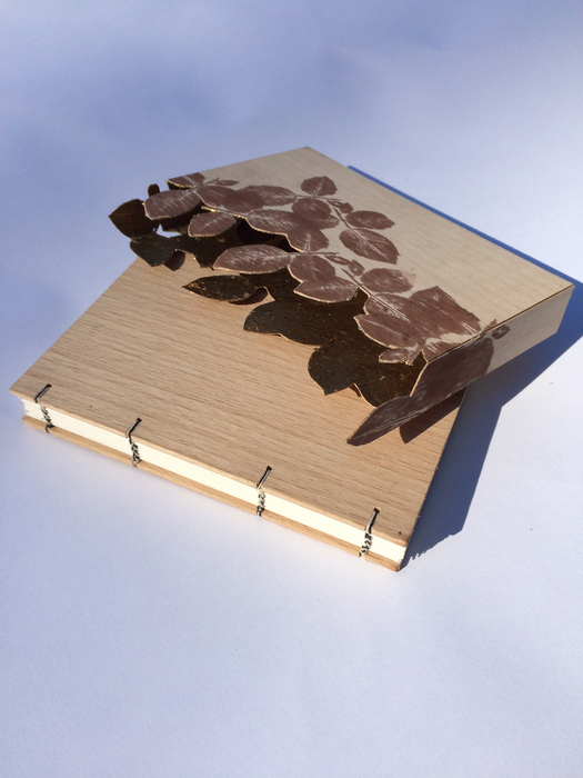 Melanie Brauner,  Untitled , 2015  Coptic binding, oak, maple, archival ink, sekisu, 14K gold  6 x 4 x .75 in.  $300