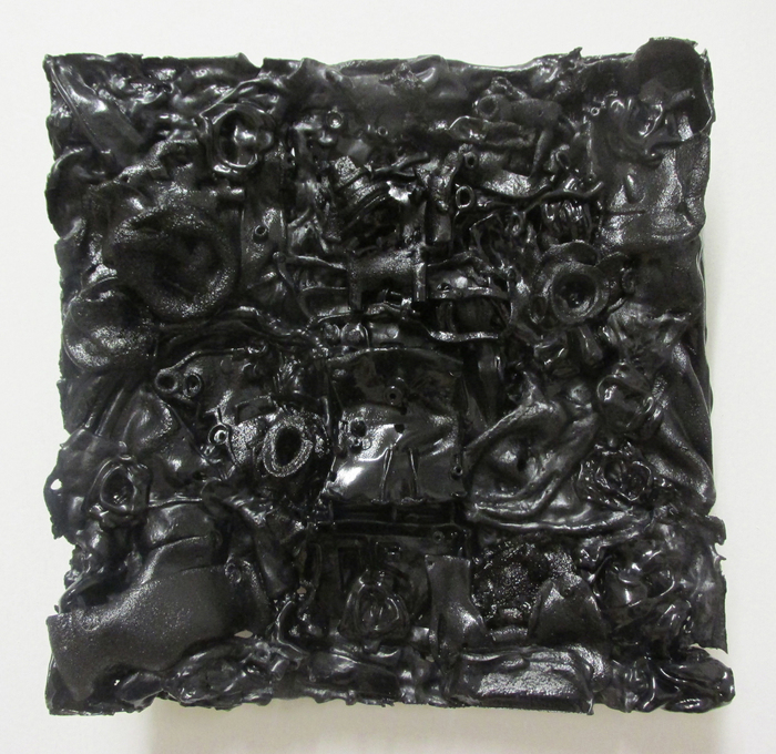 Patrick Craig,  Backmare , 2015  Re-purposed plastic  10 x 10 x 1 in.  $800   Funded in part by Univ of MA Grad School - Courtesy of Gallery planB