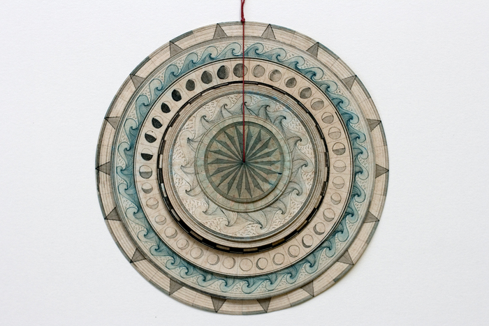 Travis Morehead,  Meditation Compass N  °3 - 8 rotating dials , 2015  Paper, ink, tea, beeswax, linen thread  6 x 6 in.  $450