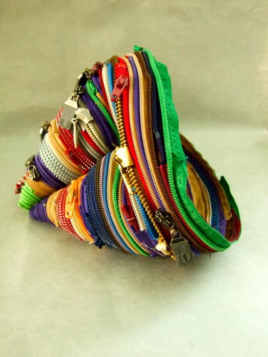 Elizabeth Morisette,  Geode , 2011  Sewn zippers  5 x 5.5 x 9 in.  $250