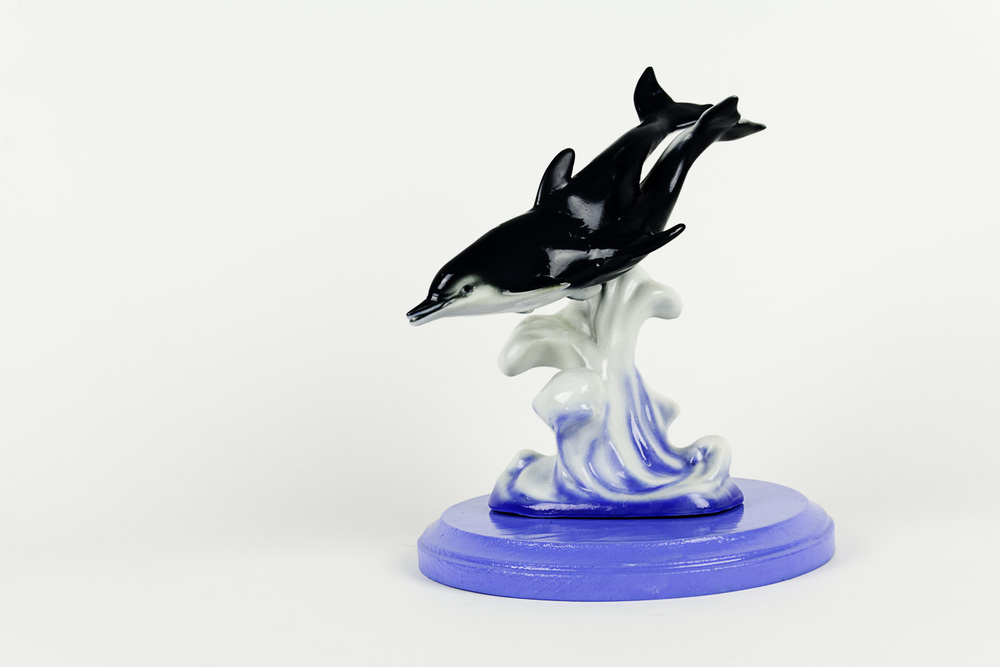 Debra Broz  Fun with a Porpoise, 2011    Found ceramic objects, epoxy compound, paint, sealer on wooden stand
