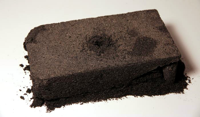 "Andy Behrle     Mission Beach Brick  (57  *  47  '  58  .  39  "" N,   152  *   22  '  08  .  56  "" W  ) , 2012  Volcanic sand and binder (Kodiak Island, Alaska)"