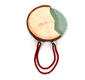 Randy Long      Short Story #2 Brooch , 2012    Wood, leather, oxidized silver, seed beads, thread, steel