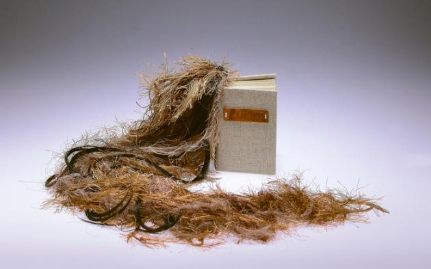 Macey Ley, I Am Not , 2014.  letterpress, paper, copper, hemp, yarn, not virgin hair  4.125 x 2.875 x 1.625 in.  $650